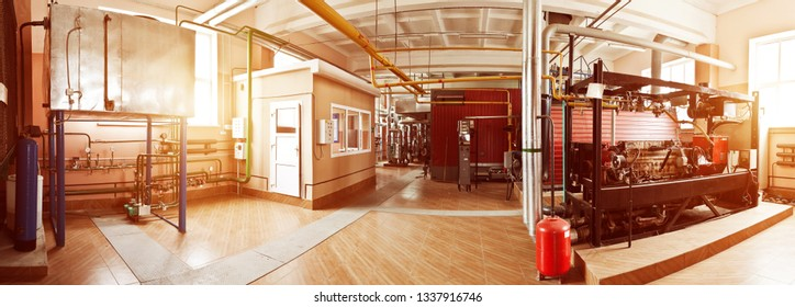Interior of the boiler room with gas disassembled boiler and pipes for supplying gas and steam. Sunflare. Panoramic view