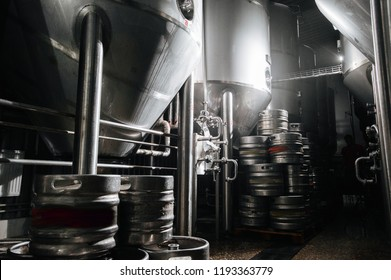 The interior of the brewery. Modern beer factory. Rows of steel stainless tanks for beer fermentation and maturation. Shop brewery. Geometry of plant.