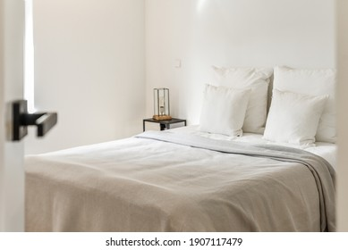 Interior of bright bedroom. Cozy bright bedroom interior. Modern bedroom design