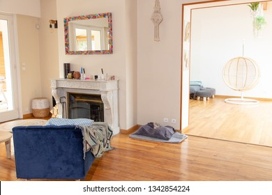 interior of bright house with fireplace and wood floor