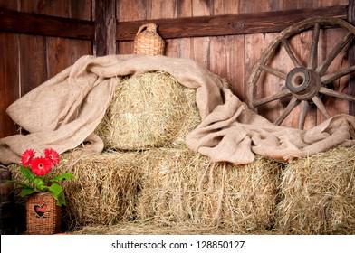 The interior of the building of the village. Wheel, hay, bucket,