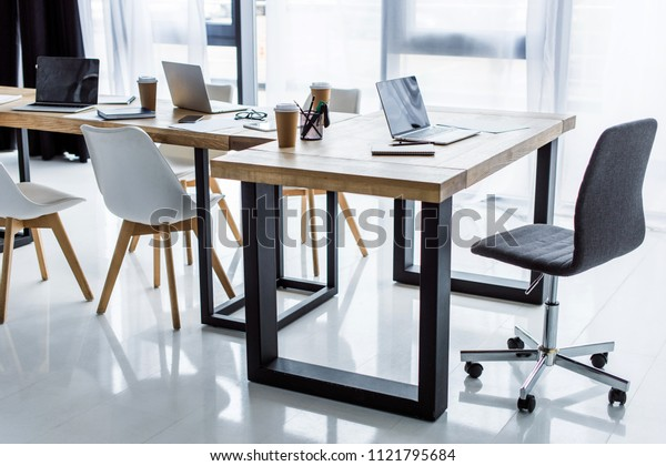 interior of business office with laptops on tables