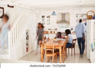 Interior Of Busy Family Home With Blurred Figures