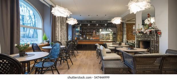Interior of caffe restaurant. Panorama. Modern design.