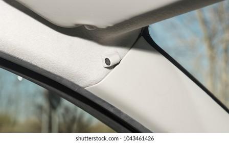 Interior of a car with closeup of  anti-theft alarm sensor