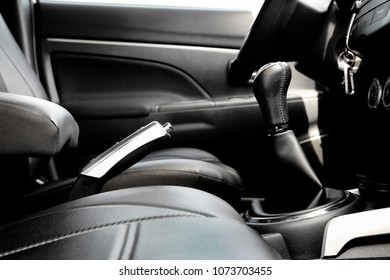 interior of car with leather seats and chrome handbrake