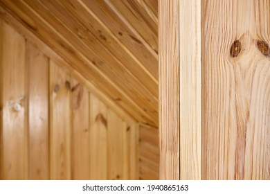 Interior carpentry closeup background. Softwood clapboard, batten, plank timber blockhouse plank, or plank beam background with copyspace. Corner of rustic room finished with blockhouse or clapboard.