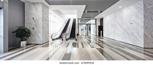 interior of center with escalator in modern office building