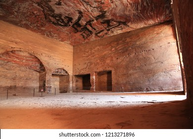 Interior chamber of Urn Tomb of the Royal Tombs with niches carved out when it was converted into a church in Petra - ancient historical and archaeological rock-cut city in Hashemite Kingdom of Jordan