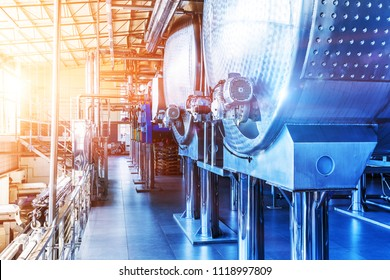 Interior of chemical factory or plant workshop with metal industrial manufacturing production equipment