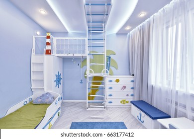 The interior of a children's bedroom for a boy in a marine style.