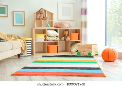 Interior of child's room with colorful carpet