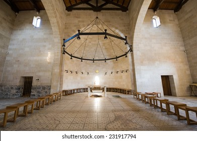Interior of the Church of the Multiplication of the Loaves and Fish with the rock under the altar where Jesus placed the fish and bread