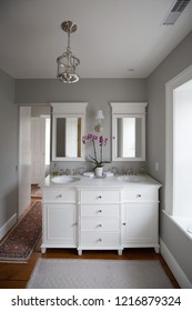 interior of a classic Georgian Home. Bathroom vanity and chandelier.