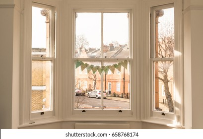 Interior of a classic victorian British house with old victorian windows facing a characteristic British mews.