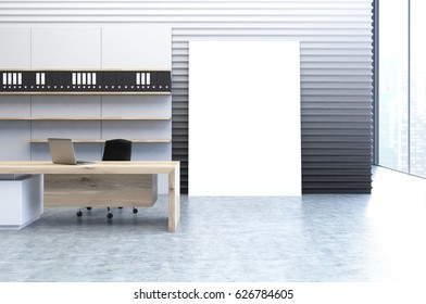 Interior of a clerk office with a gray wall, a veritcal poster standing beside it, a wooden desk and a bookcase with folders. 3d rendering, mock up