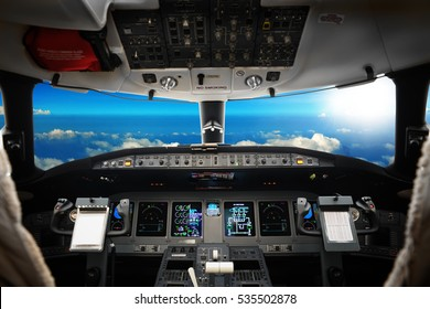 The interior of cockpit modern business jet, against a beautiful sky, background