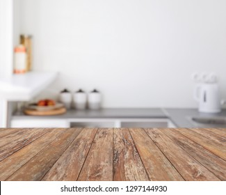 interior concept - empty wooden boards with blurred kitchen background