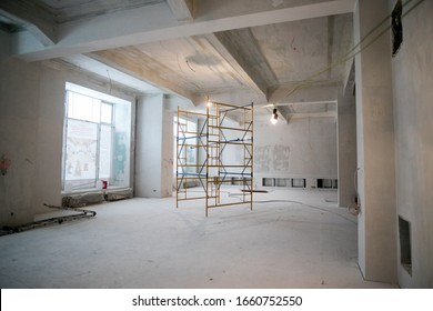 Interior construction of warehouse concrete wall and scaffolding.