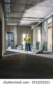 Interior construction works in a building being inspected by two workers