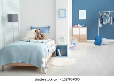 Interior of cozy children's room with comfortable bed