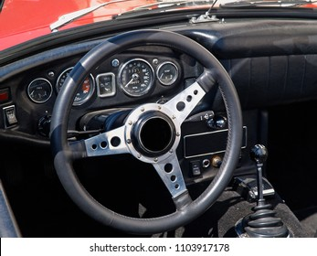 Interior and dashboard detail of a restored retro soft-top famous classical sports car