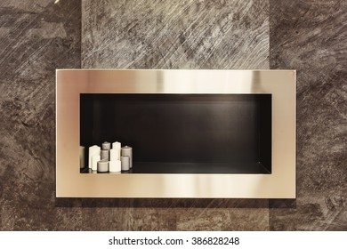 interior decor details: candles in rectangular niche in stone wall