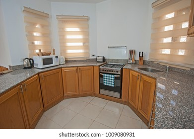 Interior decor kitchen design with appliances and furnishings in luxury show home apartment