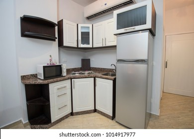 Interior decor kitchen design with appliances and furnishings in modern compact small luxury show home apartment
