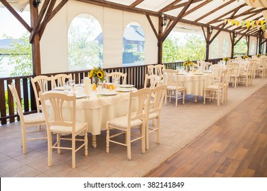 interior of a decorated wedding tent