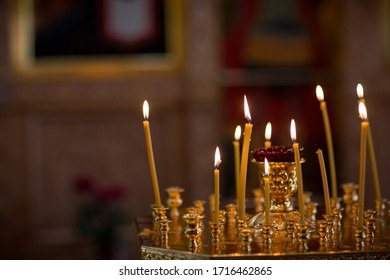 interior decoration of a Christian village church with icons and candles