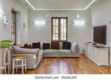 Interior decoration of a living room, sofa and tv