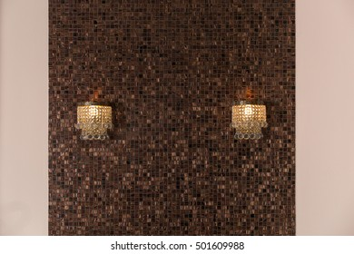 Interior decoration with mosaic tiles and lamps
