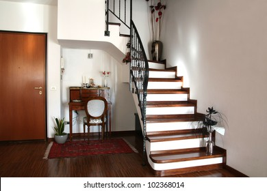 Interior decoration of a room with stairs and antique desk with chair