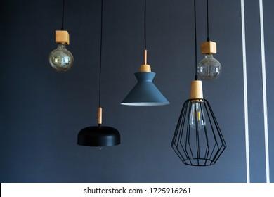 Interior decoration of stylish housing. Loft style incandescent lamp. Modern style home design.