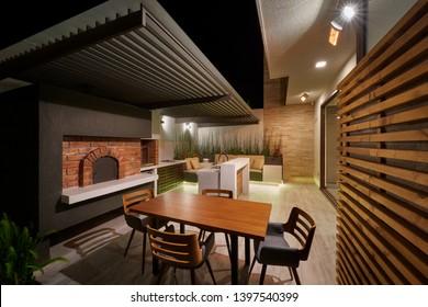 Interior design: Beautiful modern BBQ lounge at night