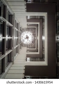 Interior design. Bottom view to chandelier, tall window and levels