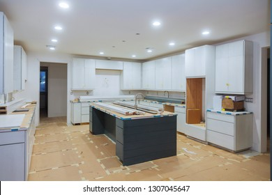 Interior design construction of a kitchen with cabinet maker installing custom