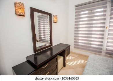 Interior design decor furnishing of luxury show home holiday villa bedroom with mirror and dressing table