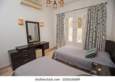 Interior design decor furnishing of luxury show home tropical villa bedroom with furniture and garden view window