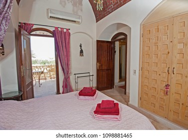 Interior design decor furnishing of luxury show home villa double bedroom with furniture and sea view patio terrace