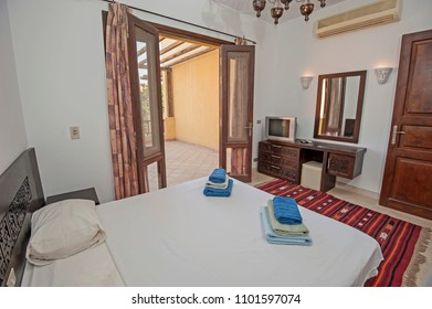 Interior design decor furnishing of luxury show home double bedroom with furniture and patio terrace area