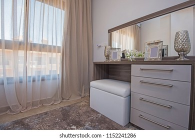 Interior design decor furnishing of luxury show home bedroom with dressing table and window