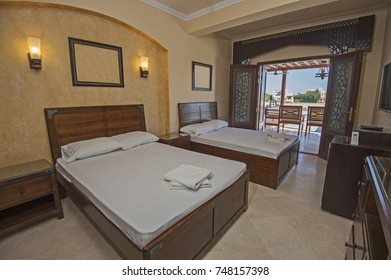 Interior design decor furnishing of luxury show home bedroom with furniture and sea view patio terrace