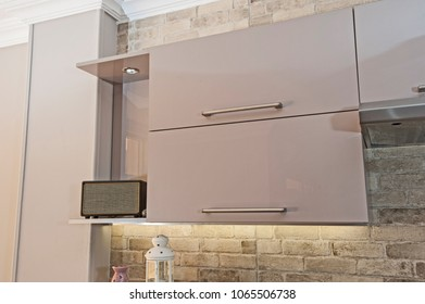 Interior design decor of kitchen in luxury apartment showing closeup detail of cupboard with handle