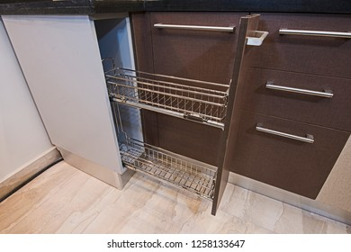 Interior design decor of kitchen in luxury apartment showing closeup detail of sliding cupboard with shelves