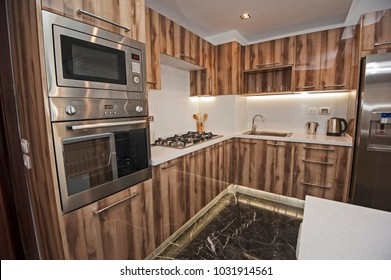Interior design decor showing modern kitchen and appliances in luxury apartment showroom