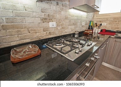 Interior design decor showing modern kitchen and cooker appliance in luxury apartment showroom