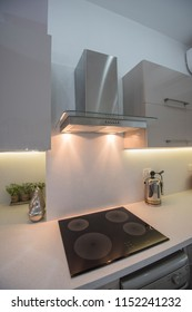 Interior design decor showing modern kitchen and cooker appliances in luxury apartment showroom
