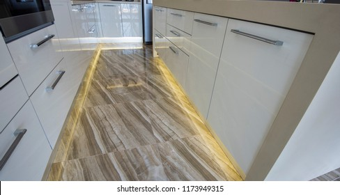 Interior design decor showing modern kitchen with led lighting in luxury apartment showroom